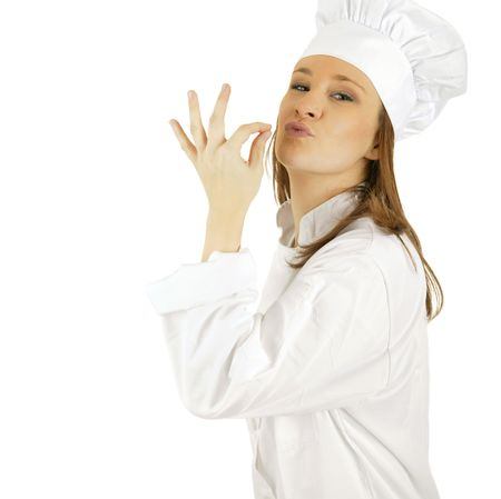 caucasian chef making tip with her hand in front of mouth to symbolize deliciousness Stock Photo