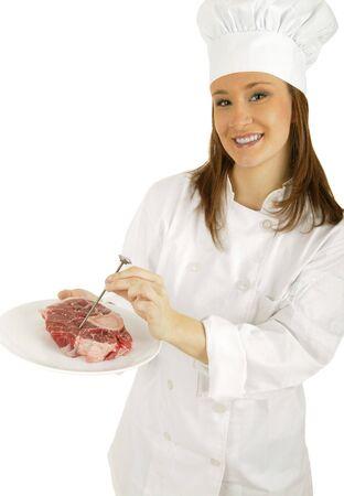limpieza: muchacha cauc�sica que mide la carne cruda con control de la temperatura