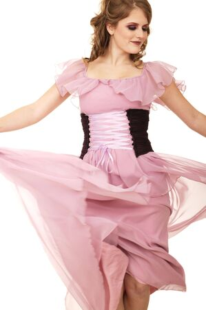 fashion shot of a caucasian girl throwing her dress to create motion
