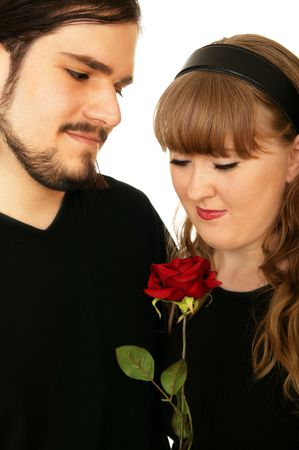 couple sharing love or  symbolize with red rose photo