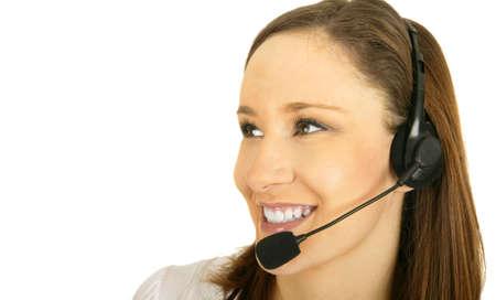 smiling caucasian girl wearing headset as customer representative looking to the side 版權商用圖片