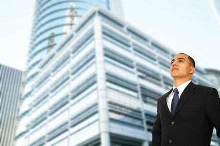 business man standing by contemporary design office building in downtown area Archivio Fotografico