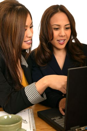 business team working together. one woman pointing at the laptop and the other looking Stock Photo - 2629162
