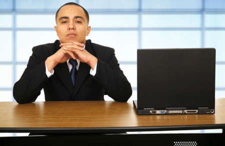 refusal: a man sit next to his laptop represent his refusal to work or waiting for something Stock Photo