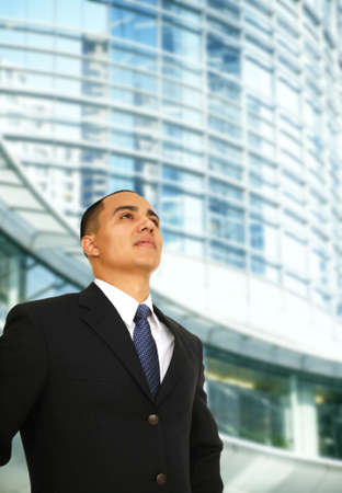 man over look to the top and standing in front of contemporary downtown building Stock Photo