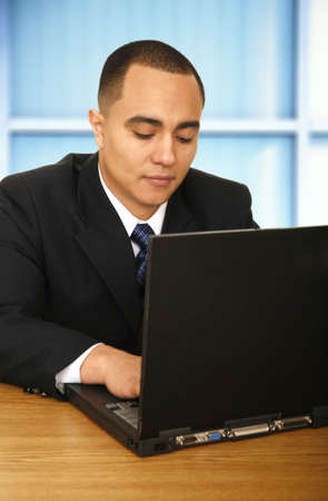 business man working with his laptop in contemporary business environment