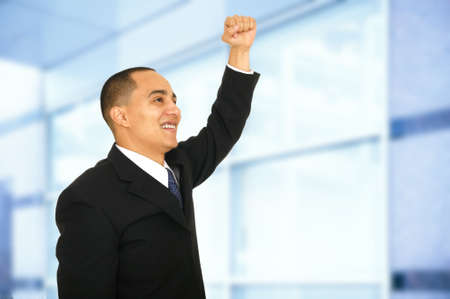 promoted: a man raised his hand with satisfaction expression when he just got promoted