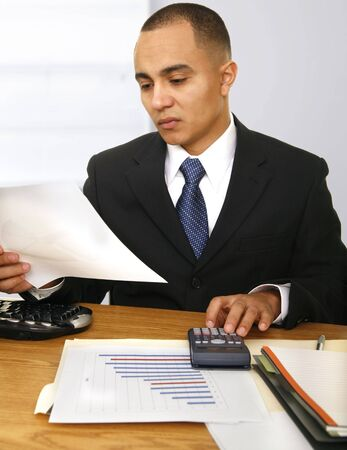 a business man calculating his or company finances position