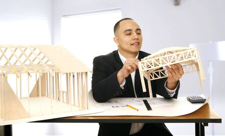 architect design inspecting his work in his modern and contemporary office