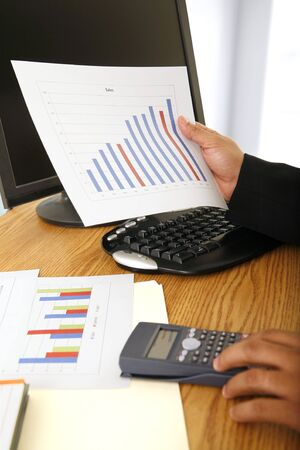 close up shot of sales figure and a pair hand of business man Stock Photo