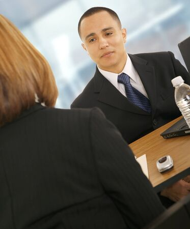 a business man talking to business woman. concept for business team, work related or consulting photo
