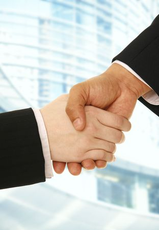 hand shake of business man and woman making a deal with contemporary abstract on the background Фото со стока