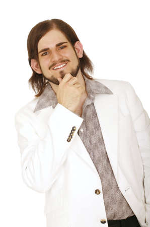 happy young man in white casual coat holding his beard photo