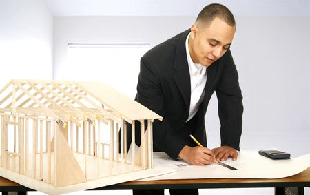 architect drawing a floor plan in his office