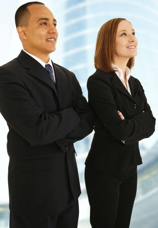 team vision: two business people smiling looking up to the side and smiling. concept for business team vision or success