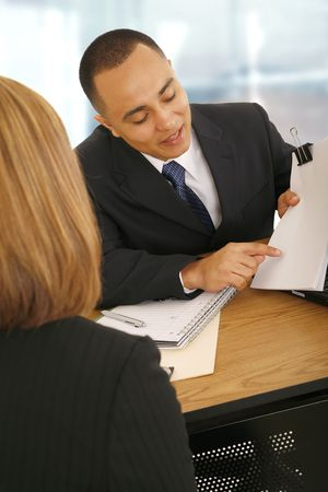 business man showing empty paper to business woman. concept for selling, meeting, consulting, or business related