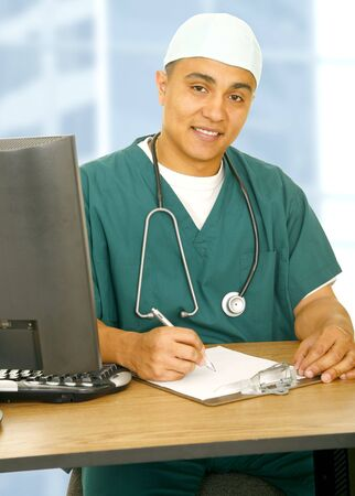 nurse in medical uniform sitting and writing on clip board showing happy expression photo