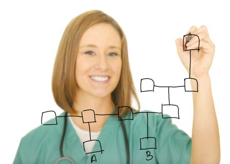 a nurse smiling to camera, isolated on white background, drawing a network of squares. focus on her hand