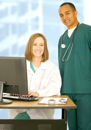 two medical staff posing as successful personnel standing with smile and confident photo
