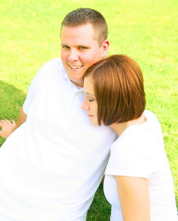 happy couple embracing and playing in the park. concept for family and young people Stock Photo - 3329078
