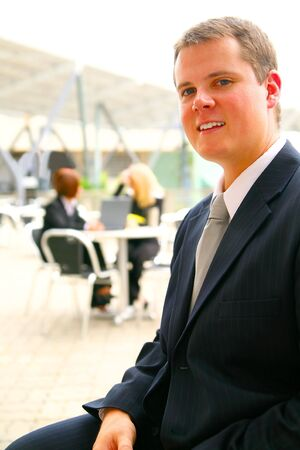 young and successful business man sitting with his coworker on the back working Stock Photo - 3383775