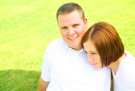 happy couple embracing and playing in the park. concept for  and young people Stock Photo - 3383783