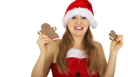 mrs santa claus holding plastic-wrapped gingerbread photo