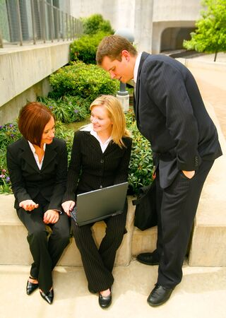 business man looking at laptop held by his coworker Stock Photo - 3447969