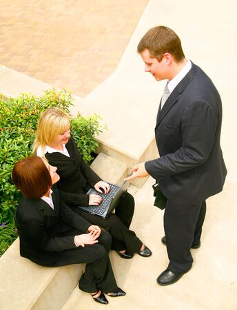 business team having informal discussion outdoor in the park area Stock Photo - 3447968