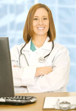 doctor woman looking to camera with smile and folding her hand. sit on her desk photo