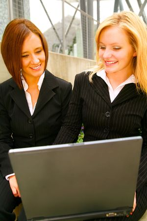 two business women looking at laptop with happy expression. concept for business