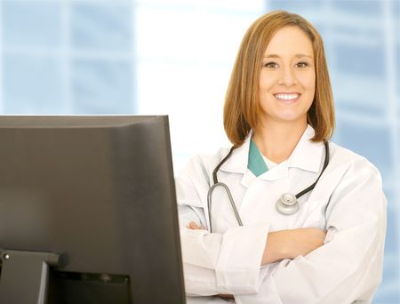 happy and pretty young woman showing confident pose as doctor looking at camera photo