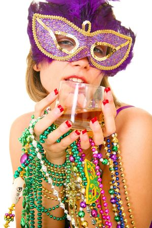 close up young and beautiful caucasian in colorful mardi gras dress holding a lot of beads and whisky for drinking
