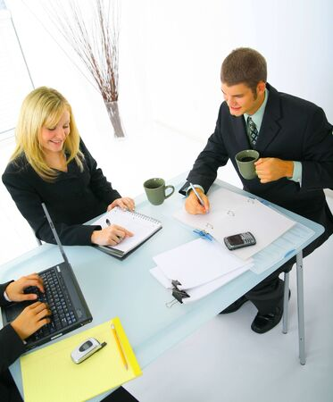 businessteam: shot of business people working together. concept for businessteam and team work