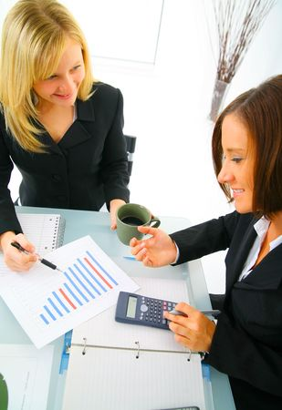 businesswoman showing financial chart to other coworker. concept for financial, business sales, and success photo
