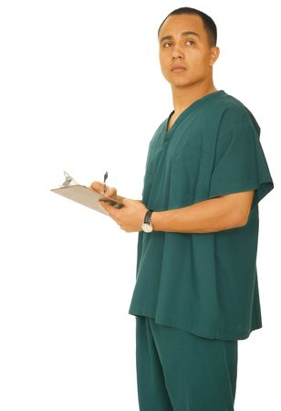 isolated shot of handsome male nurse writing something on clip board and thinking at the same time