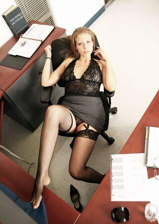 sexy secretary doing taking break in her office Stock Photo - 3773678