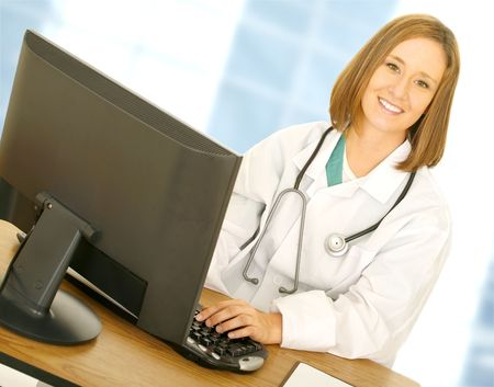 doctor woman working with computer in her modern office showing happy expression
