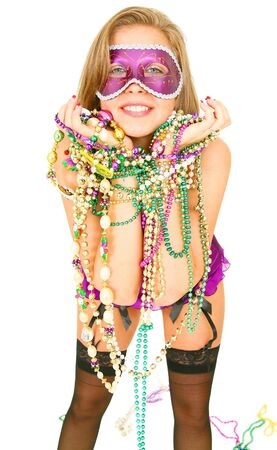 mardi: young and beautiful caucasian in colorful mardi gras dress wearing a lot of beads