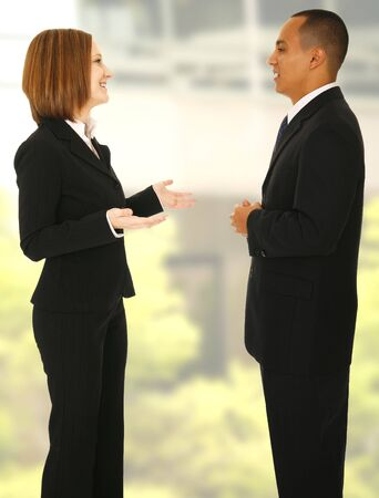 two business man talking to each other in office like environment photo