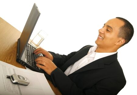 isolated on white shot of happy business man typing on his laptop with office desk setting photo