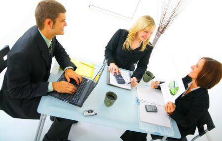 happy business people in the middle of meeting, talking about pie chart. concept for team work and businessteam
