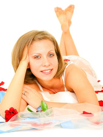 beautiful caucasian bride in lingerie laying on her gown and smiling Stock Photo - 3755623