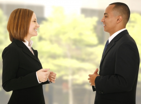 close up shot of two business people talking to each other while making gesture. concept for business dicussion photo