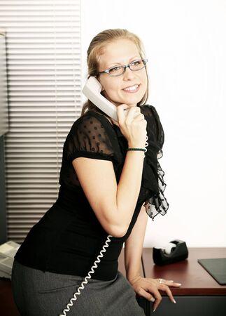 beautiful caucasian secretary working in her office photo