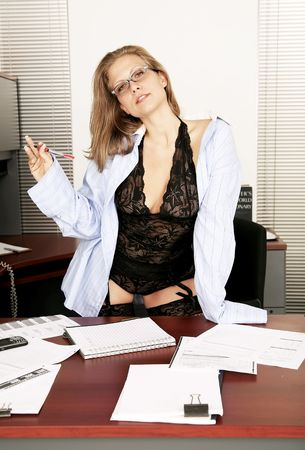sexy secretary doing working in her office and greeting her boss photo