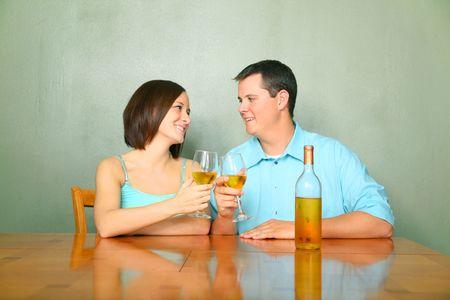 happy caucasian young couple toasting wine glass Archivio Fotografico