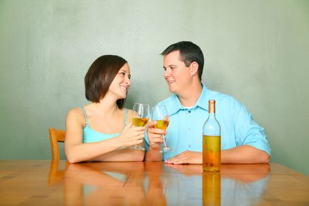 happy caucasian young couple toasting wine glass photo