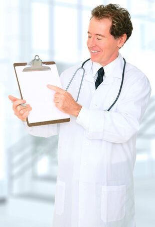 senior caucasian doctor point to an empty and blank clipboard photo