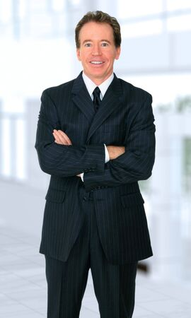 successful senior business male caucasian folding hand and standing by his office
